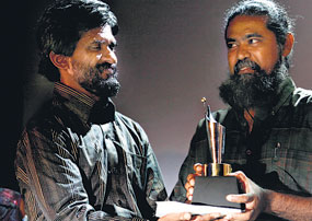 Poddala Jayantha (at left) was known for his beard