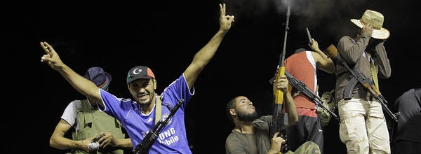 Rebel fighters gestured and fire into the air as they celebrated overrunning Muammar Qaddafi's compound in Tripoli, Libya, on Aug. 24. Strains are emerging among the factions that united to overthrow the regime. Picture taken from the Christian Science Monitor