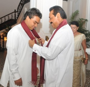 Namal Rajapakse seen here thanking his father minutes before taking oaths as a member of parliament. Photo by Chandana Perera