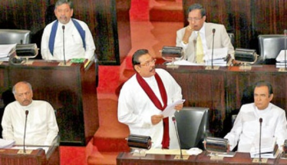 President-Rajapaksa in Parliament on Thursday (August 25, 2011) reads out proposal to end Emergency Regulations