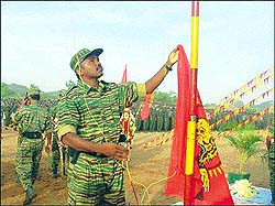 LTTE strongman and once Pirapaharan's most trusted lieutenant colonel Karuna hoists the LTTE flag at a passing out ceremony of 255 female cadre in 2003. Karuna is now a member of President Rajapakse's government