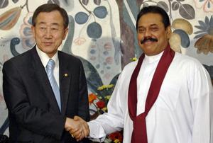 United Nations Secretary-General Ban shakes the hand of Sri Lankan President Rajapaksa at the presidential residence in Kandy