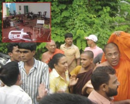 Picture shows scenes after a church was attacked on July 6, 2008 by a large mob led by Buddhist monks