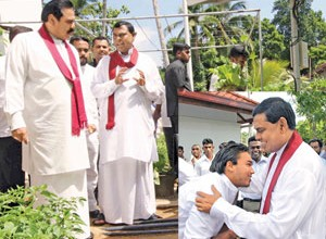 President Mahinda Rajapakse and younger brother and cabinet Minister Basil Rajapakse. President Rajapakse's son Namal - a government MP worships uncle Basil (Inset). President Rajapakse's other two siblings Gotabaya Rajapakse and Chamal Rajapakse are the Defence Secretary and the Speaker. Various other nephews and relatives  adorn other government positions. Together the Rajapakse family control 85 percent of the country's wealth