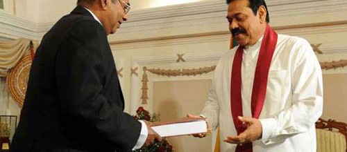 Former Attorney General and Commission Chairman CR De Silva hands over the LLRC report to President Rajapakse on November 20, 2011 at his residence at Temple Trees in Colombo, Sri Lanka