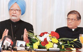 India's Prime Minister Manmohan Singh with External Affairs Minister Krishna