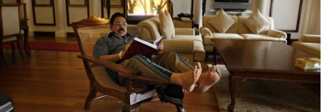 Mahinda Rajapakse reads the LLRC report at his official residence in Colombo