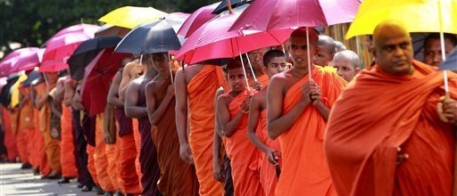 Buddhist monks, supporters of the government, march towards the U.S. Embassy, to urge the United States to withdraw its support for a proposed U.N. Human Rights Council resolution on alleged abuses during the country's civil war, in Colombo, Sri Lanka, Wednesday, March 14, 2012