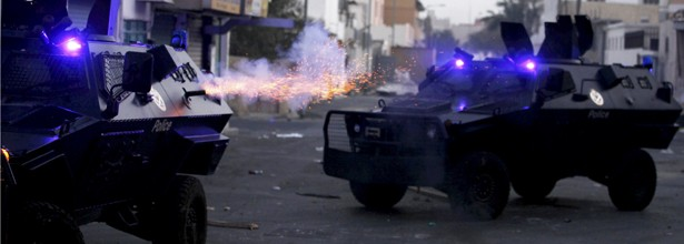 Police armoured personnel fire tear gas at anti-government protesters in the village of Sanabis, west of Manama, February 14, 2012. Anti-government protesters tried to march from all directions to reach to the junction but riot police dispersed them by firing tear-gas, rubber bullets and sound grenades. At least 25 protesters have been arrested throughout the daylong protests across the country.Photo taken from The Atlantic