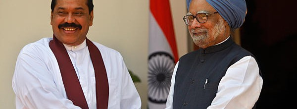 President Rajapaksa with Prime Minister Manmohan Singh. (File photo)