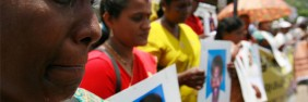 A demonstrator cries while holding a picture of her relative who went missing during Sri Lanka's war with the Liberation Tigers of Tamil Eelam (LTTE) as she takes part in a protest in Colombo September 9, 2009
