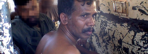 ramesh interrogated in n armoured personnel carrier (Photo courtesy The Global Mail)