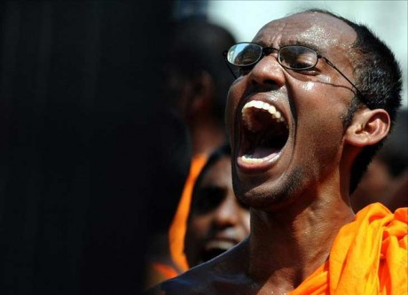 """Sri Lanka's State run media and sections of the Buddhist clergy reacted angrily to a US-led resolution passed in March 2012 demanding a war crimes probe and said the island had done well to go down fighting at the UN Human Rights Council in Geneva.The state-run Daily News said the 24 nations which voted in favour of the resolution urging a credible investigation into alleged war crimes during Sri Lanka's battle against Tamil rebels in 2009 were being destructive. The countries that backed the resolution were making """"a desperate attempt to disempower and undermine Sri Lanka and they are trying every trick in the bag to further this dark design,"""" the Daily News said. (Photo shows a protesting monk)"""