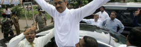 Sri Lankan presidential candidate of the common opposition  Gen. Sarath Fonseka waves to his supporters after filing his nomination,  in Colombo, Sri Lanka in 2010