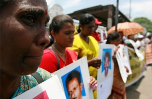 A demonstrator cries while holding a picture of her relative who went missing during Sri Lanka's war with the Liberation Tigers of Tamil Eelam (LTTE) as she takes part in a protest in Colombo September 9, 2009. Photo taken from Transcurrents