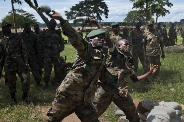 n an effort to combat al-Qaeda militants in Somalia, the United States has been training troops from other African nations to be peacekeepers.  1/10 Share ThumbsAutoplay 5 Seconds 00:0000:00 1 2 3 4 5 6 7 8 9 10  April 30, 2012  Soldiers from the Uganda People's Defence Force throw plastic bottles filled with sand as they simulate grenade throwing at the Singo training facility in Kakola, Uganda. Ben Curtis / AP Related Content