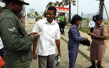 Sri Lankan security forces check identity papers of bus passengers in Colombo as part of stepped up security amid fears of more rebel attacks. Image taken from worldpress.org (File photo 2007)