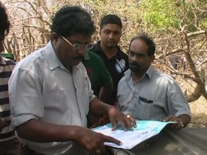 Wildlife officer Lionel checking permit which he then finds defective