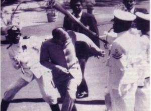 """Time magazine, in its cover story (Aug.10, 1987), provided only a skimpy three sentence description of what happened to Rajiv Gandhi on July 30, 1987. To quote Time magazine's reportage, """"As the Prime Minister strode past the white-uniformed men of a Sri Lankan naval honor guard, one of the sailors suddenly broke ranks and swung at Gandhi with the butt of his rifle. The Prime Minister ducked and received only a glancing blow on the back of his neck and left shoulder. But if he escaped serious injury in the incident, for which the Sri Lankan government quickly apologized, the Prime Minister must have realized how much strife and distrust had been aroused by the pact he had just initialed – and how uncertain were its chances of success."""" [p.7] This description was supplemented with the frontal view photo of Rajiv Gandhi leaning  forward and ducking to deflect the full force of the 'about-to land' rifle butt.  At the present moment, for understandable reasons of political prudence, neither the Indians nor the Sinhalese wish to be reminded of why Vijithamuni Rohana de Silva (a Sinhalese naval rating) attacked Rajiv Gandhi. Obviously, Indians were humiliated and that assassination attempt was a rude reality-check for the gung-ho spirit of the self-gloating India's bureaucrats who were salivating to harvest much political mileage for their diplomatic triumph in Sri Lanka. Colombo's political bigwigs of the day were embarassed beyond belief because they had been exposed by a slick operator as 'having no clothes' like the emperor in the Hans Christian Anderson story. Nevertheless, it is no secret that not an insignificant number of Sinhalese protesters (including some of the Cabinet ministers who publicly opposed the Indo-Sri Lankan Accord) would have silently gloated over Rajiv Gandhi's mishap."""
