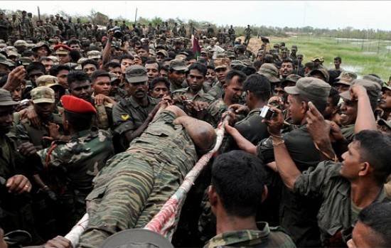 The body of slain Tiger supremo Pirapaharan carried in triumph by Sri Lankan troops.