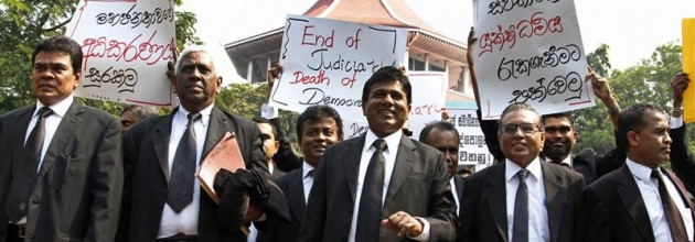 Lawyers march as they boycott court proceedings during a protest in front of the Supreme Courts in Colombo
