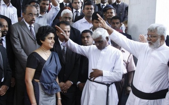 Shirani Bandaranayaka receives blessings from a section of the clergy