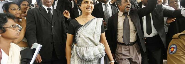 Chief Justice Shirani Bandaranayaka leaves the Supreme Court Complex to face impeachment proceedings. Photo taken from courtesy from Outlook India.com
