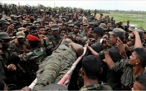 The body of the once elusive LTTE supremo Pirapaharan is carried by Sri Lanka's troops at the end of the war in May 2009