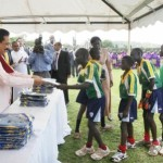 Sri Lanka's Supremo Mahinda Rajapaksa distributing T-shirts to Junior cricketers in Uganda