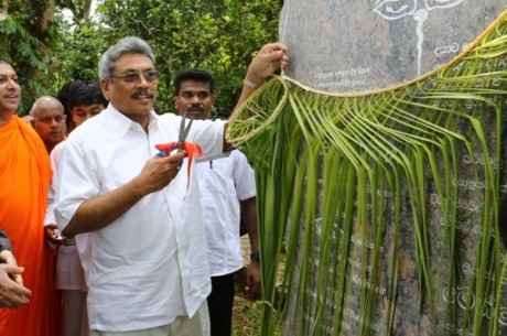 Defence Secretary Gotabaya Rajapaksa, a staunch supporter of the venomous Bodhu Bala Sena  cuts the ribbon at an opening ceremony connected with the extremist group
