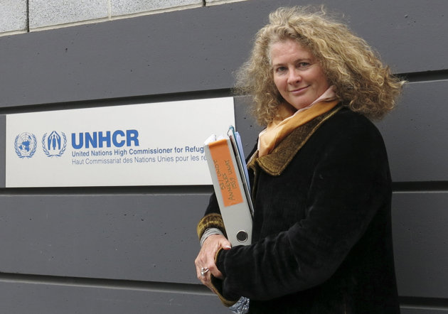 Associated Press/John Heilprin - Former U.N. refugee agency investigator Caroline Hunt-Matthes poses Wednesday, May 29, 2013, in front of her former employer's headquarters in Geneva.