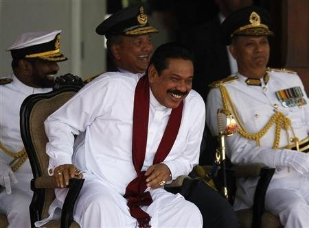 Sri Lanka's President Mahinda Rajapaksa smiles during the War Victory Parade, in Colombo May 18, 2013. Courtesy Yahoo.com